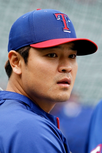 May 6, 2014; Denver, CO, USA; Texas Rangers left fielder Shin-Soo Choo (17) watches during batting practice prior to the game against the Colorado Rockies at Coors Field. Mandatory Credit: Isaiah J. Downing-USA TODAY Sports