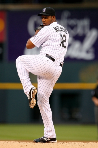 May 6, 2014; Denver, CO, USA; Colorado Rockies starting pitcher Juan Nicasio (12) pitches in the first inning against the Texas Rangers at Coors Field. Mandatory Credit: Isaiah J. Downing-USA TODAY Sports
