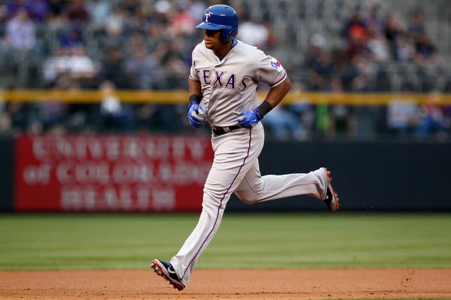 May 6, 2014; Denver, CO, USA; Texas Rangers third baseman Adrian Beltre (29) rounds the bases after hitting a home run in the first inning against the Colorado Rockies at Coors Field. Mandatory Credit: Isaiah J. Downing-USA TODAY Sports