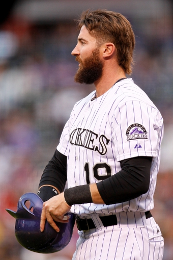May 6, 2014; Denver, CO, USA; Colorado Rockies right fielder Charlie Blackmon (19) in the on deck circle before hitting a home run in the first inning against the Texas Rangers at Coors Field. Mandatory Credit: Isaiah J. Downing-USA TODAY Sports