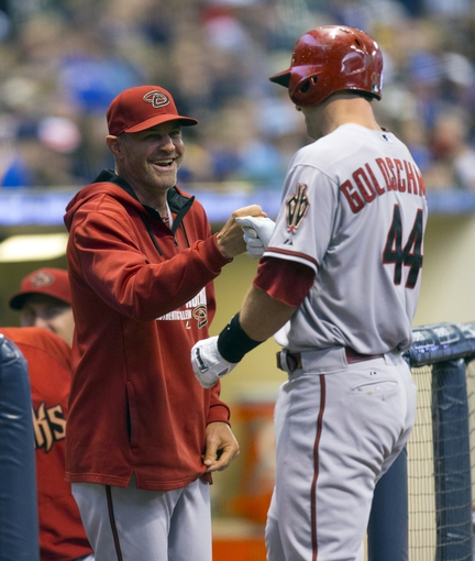 May 6, 2014; Milwaukee, WI, USA; Arizona Diamondbacks first baseman Paul Goldschmidt (44) is congratulated by manager Kirk Gibson (23) after hitting a home run during the first inning against the Milwaukee Brewers at Miller Park. Mandatory Credit: Jeff Hanisch-USA TODAY Sports