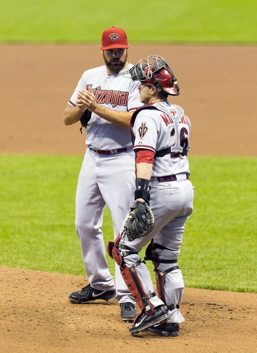 May 6, 2014; Milwaukee, WI, USA; Arizona Diamondbacks pitcher Josh Collmenter (55) talks with catcher Miguel Montero (26) during the first inning against the Milwaukee Brewers at Miller Park. Mandatory Credit: Jeff Hanisch-USA TODAY Sports