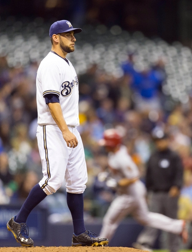 May 6, 2014; Milwaukee, WI, USA; Milwaukee Brewers pitcher Marco Estrada (41) reacts after giving up a home run to Arizona Diamondbacks shortstop Chris Owings (16) during the sixth inning at Miller Park. Mandatory Credit: Jeff Hanisch-USA TODAY Sports
