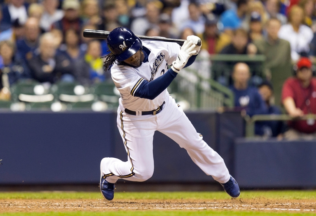 May 6, 2014; Milwaukee, WI, USA; Milwaukee Brewers second baseman Rickie Weeks (23) falls down following a swing during the sixth inning against the Arizona Diamondbacks at Miller Park. Mandatory Credit: Jeff Hanisch-USA TODAY Sports