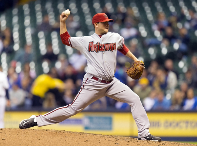 May 6, 2014; Milwaukee, WI, USA; Arizona Diamondbacks pitcher Evan Marshall (50) throws a pitch during the seventh inning against the Milwaukee Brewers at Miller Park. Mandatory Credit: Jeff Hanisch-USA TODAY Sports