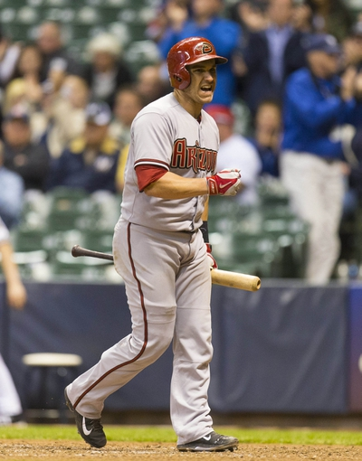May 6, 2014; Milwaukee, WI, USA; Arizona Diamondbacks catcher Miguel Montero (26) reacts after striking out with the bases loaded during the ninth inning against the Milwaukee Brewers at Miller Park. Mandatory Credit: Jeff Hanisch-USA TODAY Sports