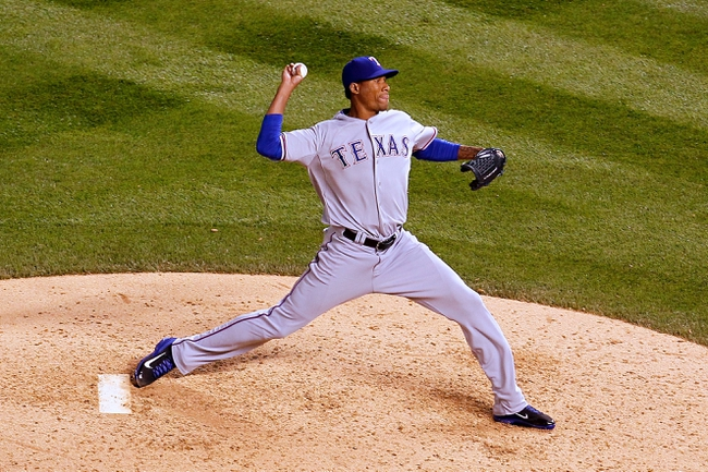 May 6, 2014; Denver, CO, USA; Texas Rangers relief pitcher Alexi Ogando (41) pitches in the sixth inning against the Colorado Rockies at Coors Field. Mandatory Credit: Isaiah J. Downing-USA TODAY Sports