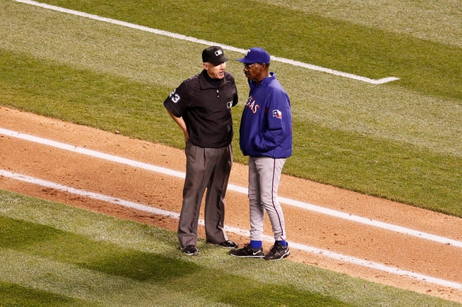 May 6, 2014; Denver, CO, USA; Texas Rangers manager Ron Washington (38) challenges a play with first base umpire Lance Barksdale (23) in the sixth inning against the Colorado Rockies at Coors Field. Mandatory Credit: Isaiah J. Downing-USA TODAY Sports