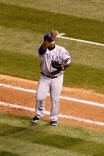 May 6, 2014; Denver, CO, USA; Texas Rangers first baseman Prince Fielder (84) motions for his manager to challenge a play in the sixth inning against the Colorado Rockies at Coors Field. Mandatory Credit: Isaiah J. Downing-USA TODAY Sports