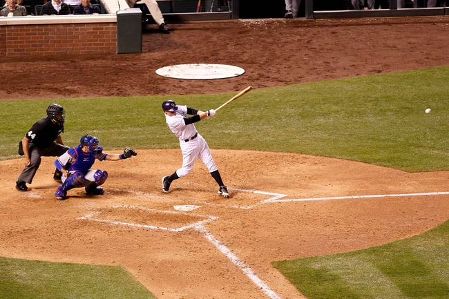 May 6, 2014; Denver, CO, USA; Colorado Rockies catcher Jordan Pacheco (58) hits an RBI single in the sixth inning against the Texas Rangers at Coors Field. Mandatory Credit: Isaiah J. Downing-USA TODAY Sports