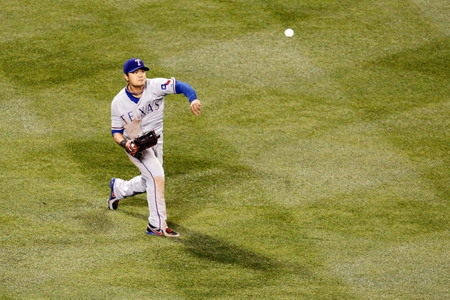 May 6, 2014; Denver, CO, USA; Texas Rangers left fielder Shin-Soo Choo (17) throws the ball in the sixth inning against the Colorado Rockies at Coors Field. Mandatory Credit: Isaiah J. Downing-USA TODAY Sports