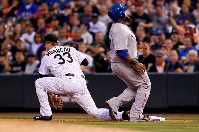 May 6, 2014; Denver, CO, USA; Texas Rangers first baseman Prince Fielder (84) is thrown out at first on a double play against Colorado Rockies first baseman Justin Morneau (33) in the fourth inning at Coors Field. Mandatory Credit: Isaiah J. Downing-USA TODAY Sports
