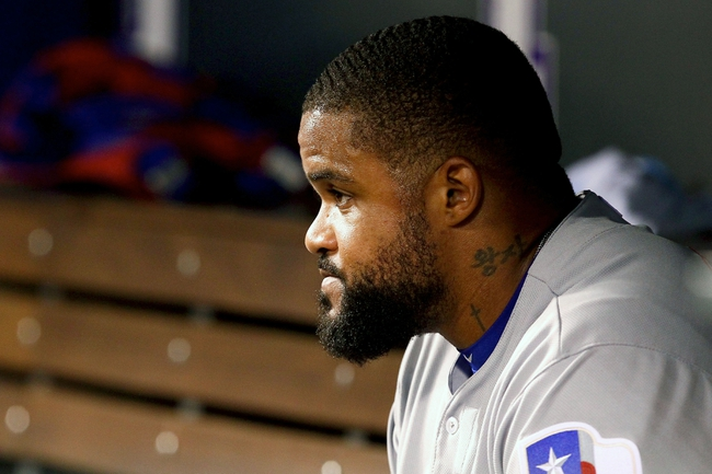 May 6, 2014; Denver, CO, USA; Texas Rangers first baseman Prince Fielder (84) in the sixth inning against the Colorado Rockies at Coors Field. Mandatory Credit: Isaiah J. Downing-USA TODAY Sports