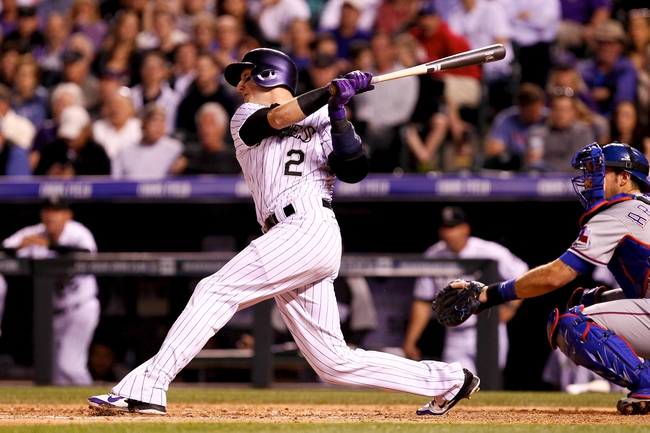 May 6, 2014; Denver, CO, USA; Colorado Rockies short stop Troy Tulowitzki (2) hits a single in the fifth inning against the Texas Rangers at Coors Field. Mandatory Credit: Isaiah J. Downing-USA TODAY Sports