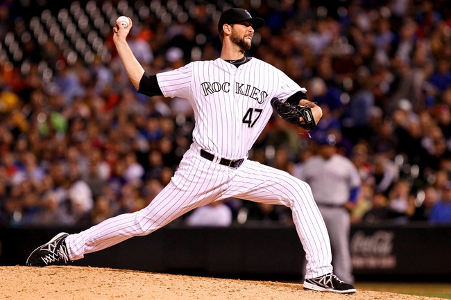 May 6, 2014; Denver, CO, USA; Colorado Rockies pitcher Chris Martin (47) throws in the sixth inning against the Texas Rangers at Coors Field. Mandatory Credit: Isaiah J. Downing-USA TODAY Sports