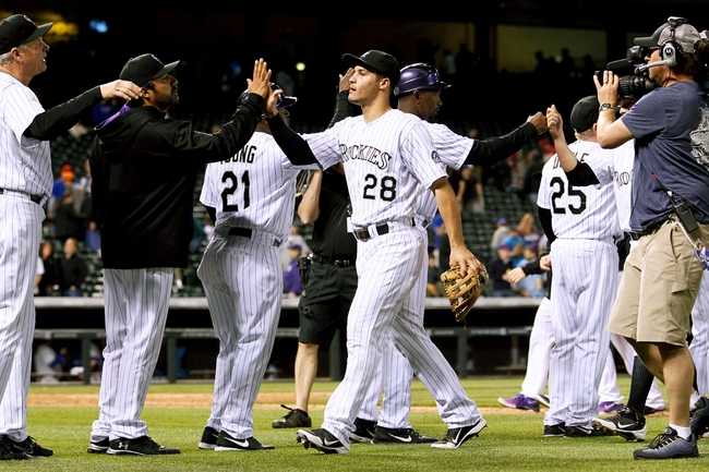 May 6, 2014; Denver, CO, USA; Colorado Rockies third baseman Nolan Arenado (28) celebrates with teammates after a win against the Texas Rangers at Coors Field. Arenando extended his hitting streak to 26 games. Mandatory Credit: Isaiah J. Downing-USA TODAY Sports