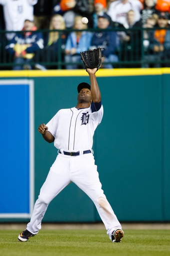 May 5, 2014; Detroit, MI, USA; Detroit Tigers right fielder Torii Hunter (48) makes a catch against the Houston Astros at Comerica Park. Mandatory Credit: Rick Osentoski-USA TODAY Sports