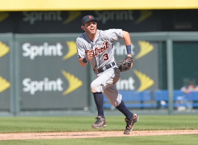 May 4, 2014; Kansas City, MO, USA; Detroit Tigers second basemen Ian Kinsler (3) charges a ground ball against the Kansas City Royals during the ninth inning at Kauffman Stadium. Mandatory Credit: Peter G. Aiken-USA TODAY Sports