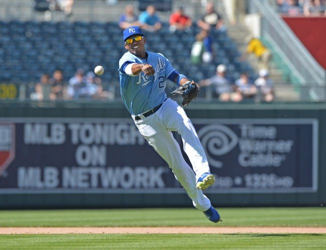 May 4, 2014; Kansas City, MO, USA; Kansas City Royals shortstop Alcides Escobar (2) delivers a throw to first for an out against the Detroit Tigers during the eighth inning at Kauffman Stadium. Mandatory Credit: Peter G. Aiken-USA TODAY Sports