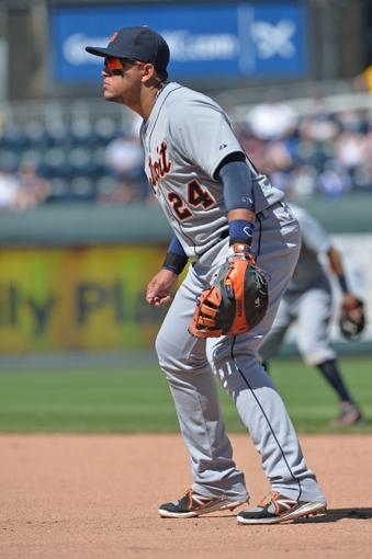 May 4, 2014; Kansas City, MO, USA; Detroit Tigers first basemen Miguel Cabrera (24) gets set on defense against the Kansas City Royals during the seventh inning at Kauffman Stadium. Mandatory Credit: Peter G. Aiken-USA TODAY Sports