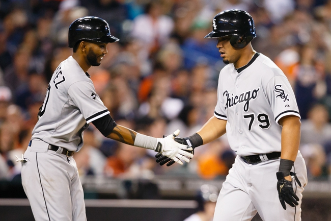 Apr 21, 2014; Detroit, MI, USA; Chicago White Sox first baseman Jose Abreu (79) receives congratulations from shortstop Alexei Ramirez (10) after scoring in the seventh inning against the Detroit Tigers at Comerica Park. Mandatory Credit: Rick Osentoski-USA TODAY Sports