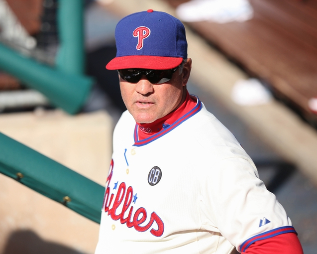May 4, 2014; Philadelphia, PA, USA; Philadelphia Phillies manager Ryne Sandberg (23) in the dugout during a game against the Washington Nationals at Citizens Bank Park. The Phillies defeated the Nationals 1-0.  Mandatory Credit: Bill Streicher-USA TODAY Sports