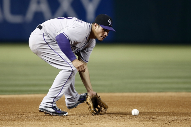 May 7, 2014; Arlington, TX, USA; Colorado Rockies third baseman Nolan Arenado (28) fields the ground-out hit by Texas Rangers right fielder Alex Rios (not pictured) during the fifth inning of a baseball game at Globe Life Park in Arlington. Mandatory Credit: Jim Cowsert-USA TODAY Sports