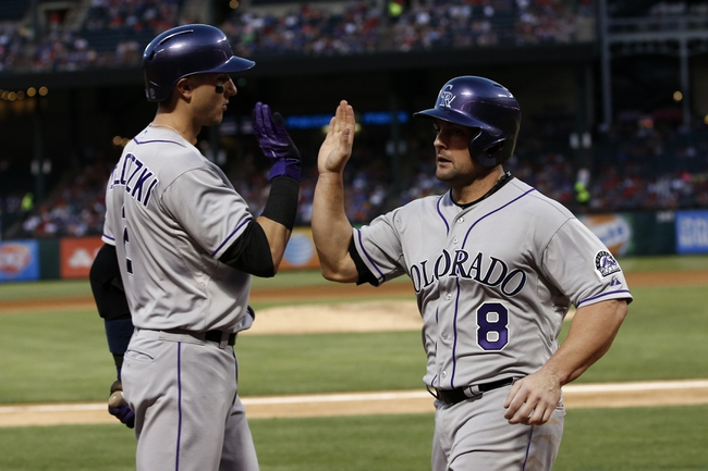 May 7, 2014; Arlington, TX, USA; Colorado Rockies catcher Michael McKenry (8) is congratulated by shortstop Troy Tulowitzki (2) after scoring against the Texas Rangers during the fourth inning of a baseball game at Globe Life Park in Arlington. Mandatory Credit: Jim Cowsert-USA TODAY Sports