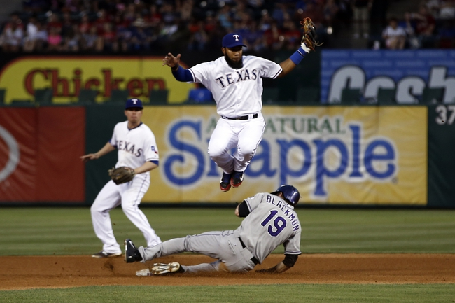 May 7, 2014; Arlington, TX, USA; Colorado Rockies right fielder Charlie Blackmon (19) steals second under Texas Rangers shortstop Elvis Andrus (1) during the fourth inning of a baseball game at Globe Life Park in Arlington. Mandatory Credit: Jim Cowsert-USA TODAY Sports