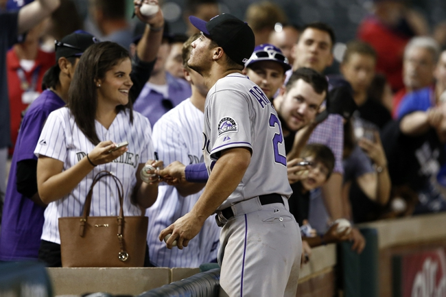 May 7, 2014; Arlington, TX, USA; Colorado Rockies third baseman Nolan Arenado (28) signs autographs following the baseball game against the Texas Rangers at Globe Life Park in Arlington. The Rockies won 9-2. Mandatory Credit: Jim Cowsert-USA TODAY Sports