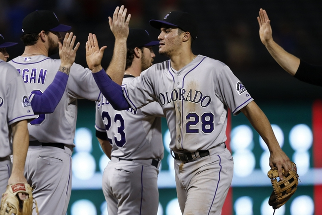 May 7, 2014; Arlington, TX, USA; Colorado Rockies third baseman Nolan Arenado (28) congratulates teammates following their 9-2 win over the Texas Rangers at Globe Life Park in Arlington. The Rockies won 9-2. Mandatory Credit: Jim Cowsert-USA TODAY Sports