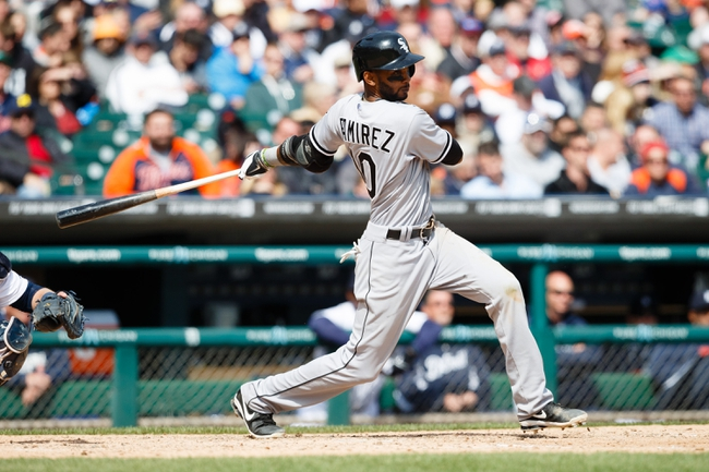 Apr 24, 2014; Detroit, MI, USA; Chicago White Sox shortstop Alexei Ramirez (10) hits an RBI single in the eighth inning against the Detroit Tigers at Comerica Park. Detroit won 7-4. Mandatory Credit: Rick Osentoski-USA TODAY Sports