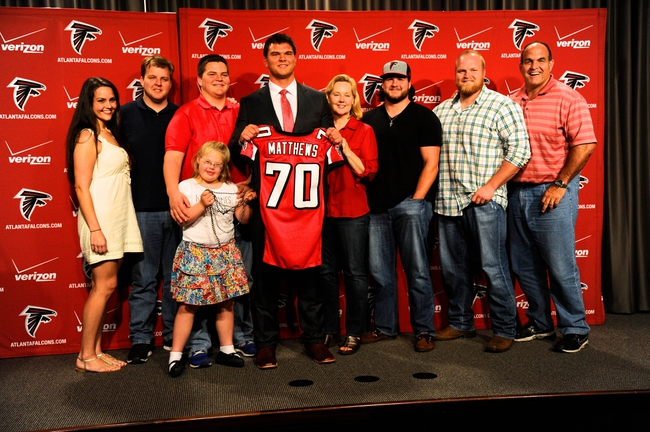 May 9, 2014; Atlanta, GA, USA; Atlanta Falcons first round draft pick tackle Jake Matthews (with jersey) shown with his