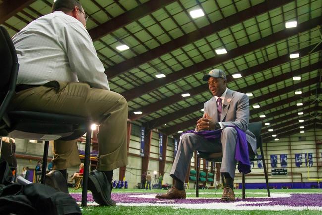 May 9, 2014; Eden Prairie, MN, USA; Minnesota Vikings quarterback Teddy Bridgewater gets interviewed by local media Darren Wolfson at Winter Park Fieldhouse. Mandatory Credit: Brad Rempel-USA TODAY Sports