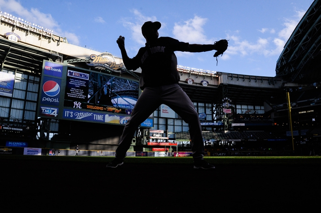 May 9, 2014; Milwaukee, WI, USA;  New York Yankees shortstop Derek Jeter (2) warms up before game against the Milwaukee Brewers at Miller Park. Mandatory Credit: Benny Sieu-USA TODAY Sports