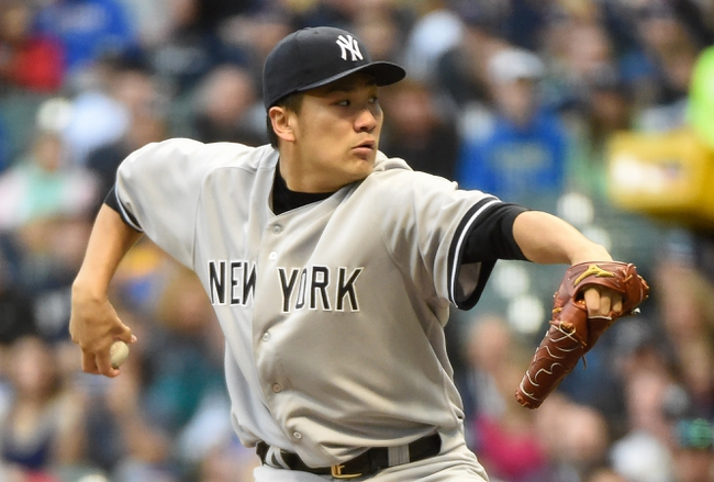 May 9, 2014; Milwaukee, WI, USA;  New York Yankees pitcher Masahiro Tanaka (19) pitches in the first inning against the Milwaukee Brewers at Miller Park. Mandatory Credit: Benny Sieu-USA TODAY Sports