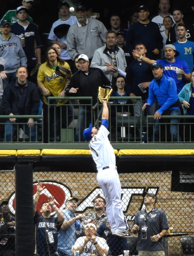 May 9, 2014; Milwaukee, WI, USA;  Milwaukee Brewers left fielder Logan Schafer (1) can't catch home run hit by New York Yankees third baseman Yangervis Solarte (not pictured) in the fourth inning at Miller Park. Mandatory Credit: Benny Sieu-USA TODAY Sports