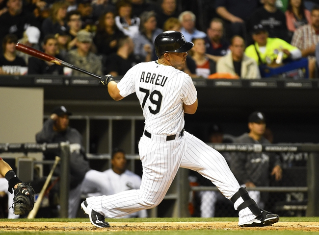May 9, 2014; Chicago, IL, USA; Chicago White Sox first baseman Jose Abreu (79) hits a single RBI against the Arizona Diamondbacks during the fourth inning at U.S Cellular Field. Mandatory Credit: Mike DiNovo-USA TODAY Sports