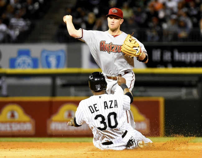 May 9, 2014; Chicago, IL, USA; Arizona Diamondbacks second baseman Aaron Hill (2) gets a double play against Chicago White Sox left fielder Alejandro De Aza (30) during the fourth inning at U.S Cellular Field. Mandatory Credit: Mike DiNovo-USA TODAY Sports