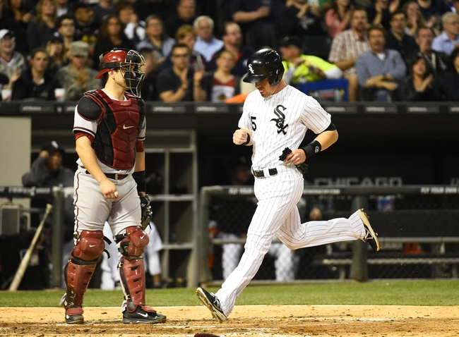 May 9, 2014; Chicago, IL, USA; Chicago White Sox second baseman Gordon Beckham (15) scores a run against the Arizona Diamondbacks during the fourth inning at U.S Cellular Field. Mandatory Credit: Mike DiNovo-USA TODAY Sports