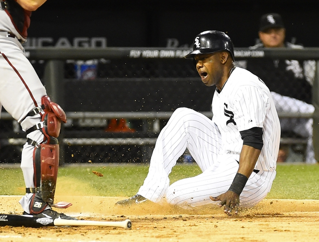 May 9, 2014; Chicago, IL, USA; Chicago White Sox left fielder Alejandro De Aza (30) slides safely against the Arizona Diamondbacks during the fourth inning at U.S Cellular Field. Mandatory Credit: Mike DiNovo-USA TODAY Sports