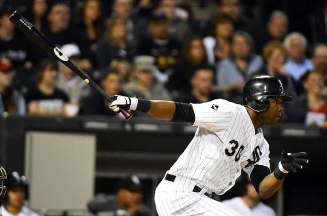 May 9, 2014; Chicago, IL, USA; Chicago White Sox left fielder Alejandro De Aza (30) hits a single against the Arizona Diamondbacks during the fourth inning at U.S Cellular Field. Mandatory Credit: Mike DiNovo-USA TODAY Sports
