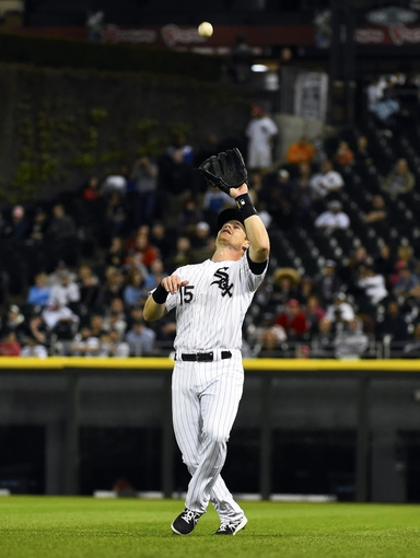 May 9, 2014; Chicago, IL, USA; Chicago White Sox second baseman Gordon Beckham (15) makes a catch against the Arizona Diamondbacks during the seventh inning at U.S Cellular Field. Mandatory Credit: Mike DiNovo-USA TODAY Sports
