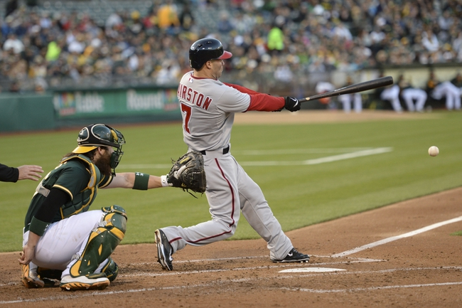 May 9, 2014; Oakland, CA, USA; Washington Nationals left fielder Scott Hairston (7) hits a double in front of Oakland Athletics catcher Derek Norris (36, left) during the second inning at O.co Coliseum. Mandatory Credit: Kyle Terada-USA TODAY Sports
