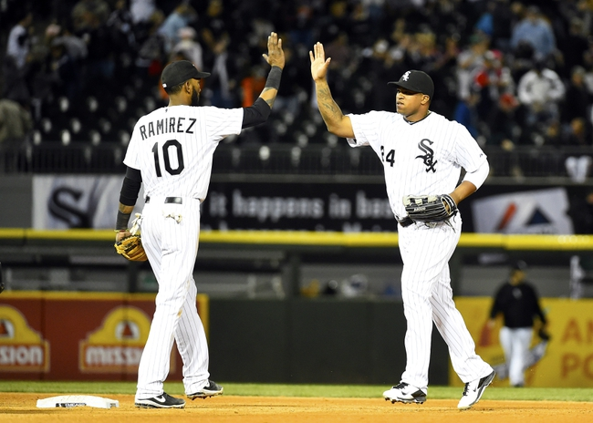 May 9, 2014; Chicago, IL, USA; Chicago White Sox shortstop Alexei Ramirez (10) reacts with right fielder Dayan Viciedo (24) after the ninth inning at U.S Cellular Field. Chicago White Sox defeats the Arizona Diamondbacks 9-3. Mandatory Credit: Mike DiNovo-USA TODAY Sports