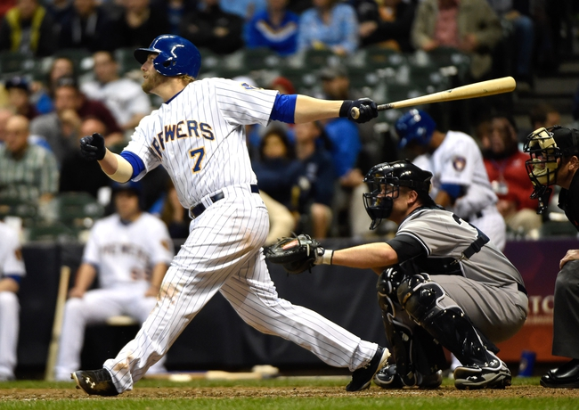 May 9, 2014; Milwaukee, WI, USA; Milwaukee Brewers first baseman Mark Reynolds (7) hits a solo home run in the ninth inning against the New York Yankees at Miller Park. Mandatory Credit: Benny Sieu-USA TODAY Sports