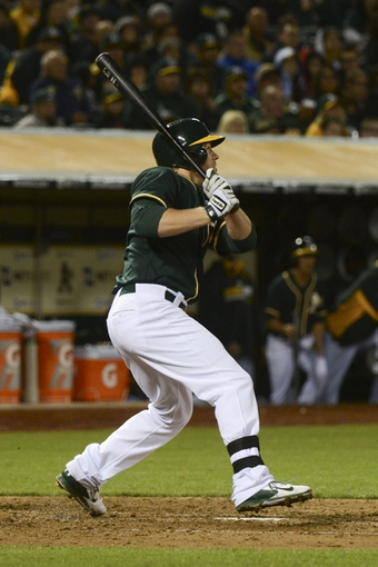 May 9, 2014; Oakland, CA, USA; Oakland Athletics first baseman Brandon Moss (37) hits a two-run home run against the Washington Nationals during the fifth inning at O.co Coliseum. Mandatory Credit: Kyle Terada-USA TODAY Sports