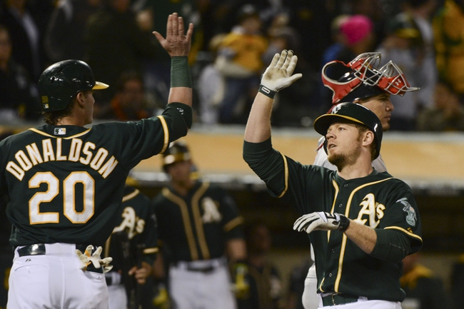 May 9, 2014; Oakland, CA, USA; Oakland Athletics first baseman Brandon Moss (37, right front) is congratulated by third baseman Josh Donaldson (20) after both scored on a two-run home run by Moss during the fifth inning as Washington Nationals catcher Wilson Ramos (40, right back) reacts at O.co Coliseum. Mandatory Credit: Kyle Terada-USA TODAY Sports