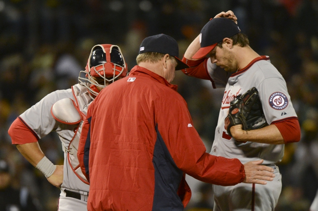 May 9, 2014; Oakland, CA, USA; Washington Nationals starting pitcher Doug Fister (58, right) receives a mound visit by pitching coach Steve McCatty (54, center) and catcher Wilson Ramos (40, left) after a two-run home run by Oakland Athletics first baseman Brandon Moss (37, not pictured) during the fifth inning at O.co Coliseum. Mandatory Credit: Kyle Terada-USA TODAY Sports