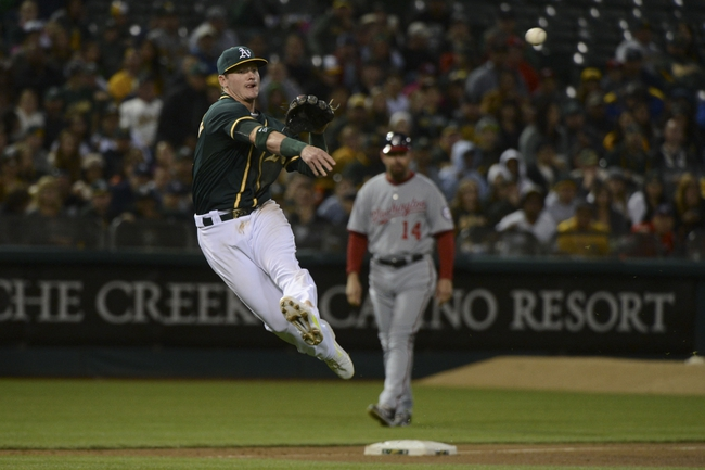 May 9, 2014; Oakland, CA, USA; Oakland Athletics third baseman Josh Donaldson (20) throws the baseball to first base for an out on Washington Nationals second baseman Danny Espinosa (8, not pictured) during the fifth inning at O.co Coliseum. Mandatory Credit: Kyle Terada-USA TODAY Sports